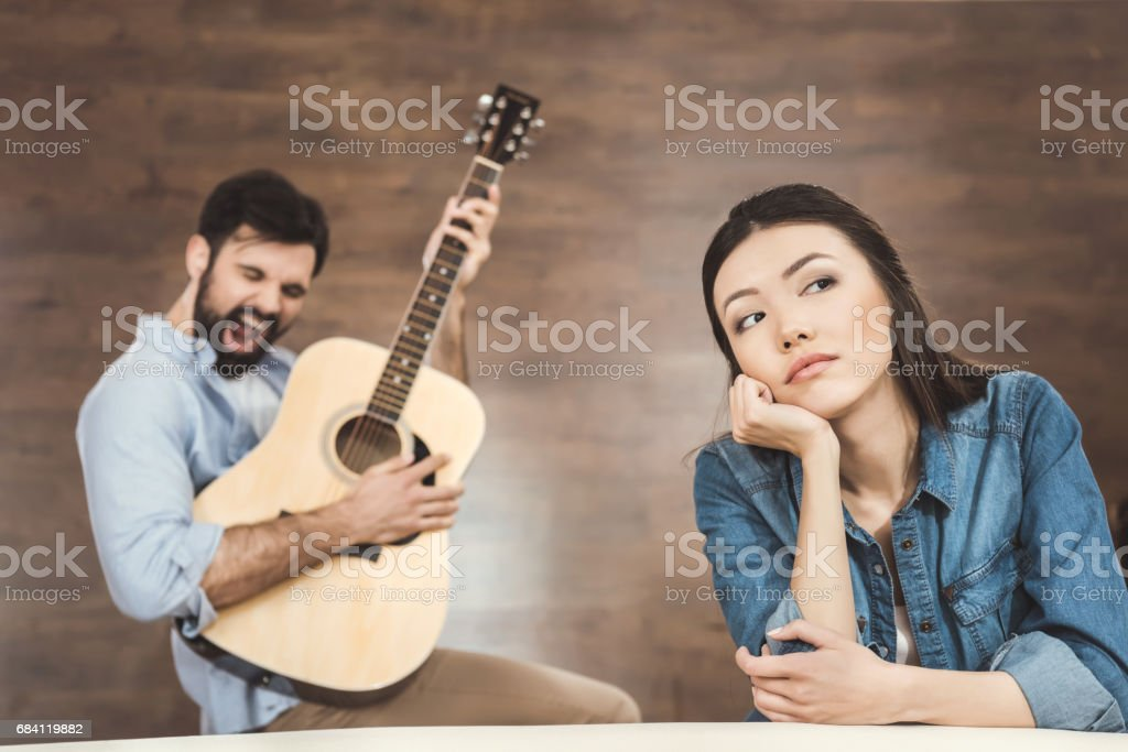 Woman daydreaming with hand on chin foto stock royalty-free