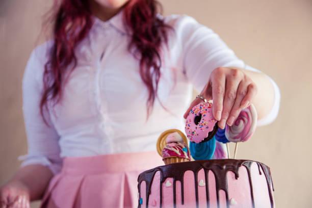 Woman decorating a cake stock photo