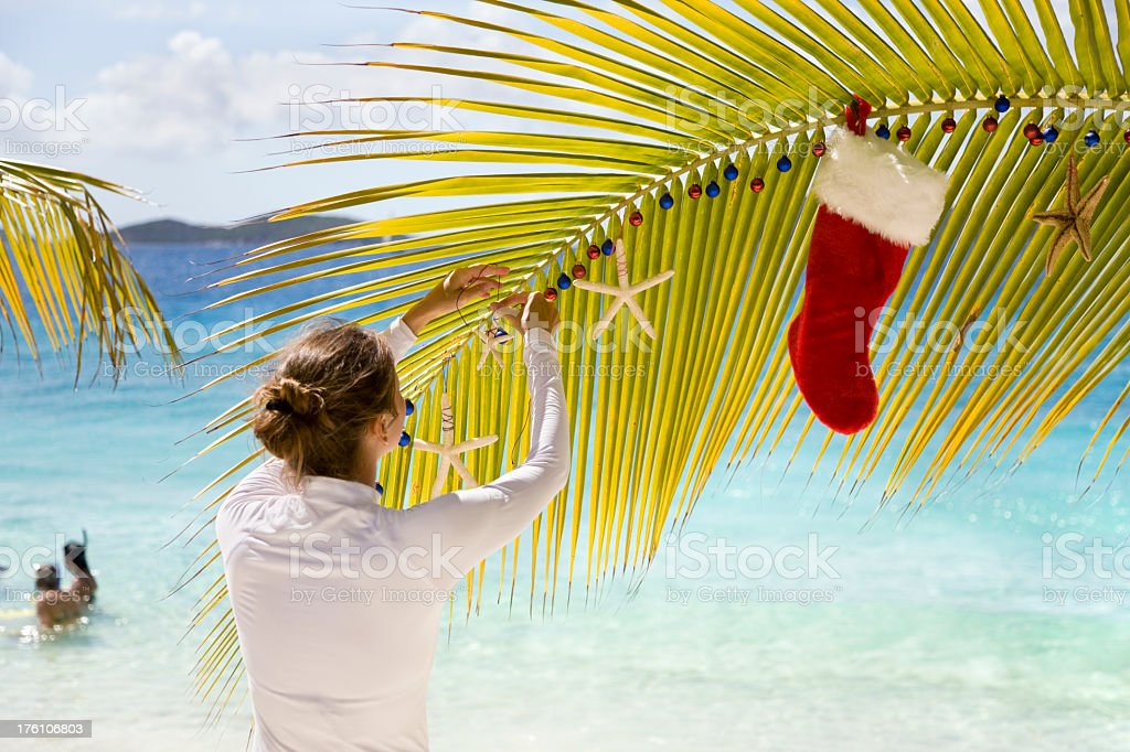 woman decorating a palm tree royalty-free stock photo