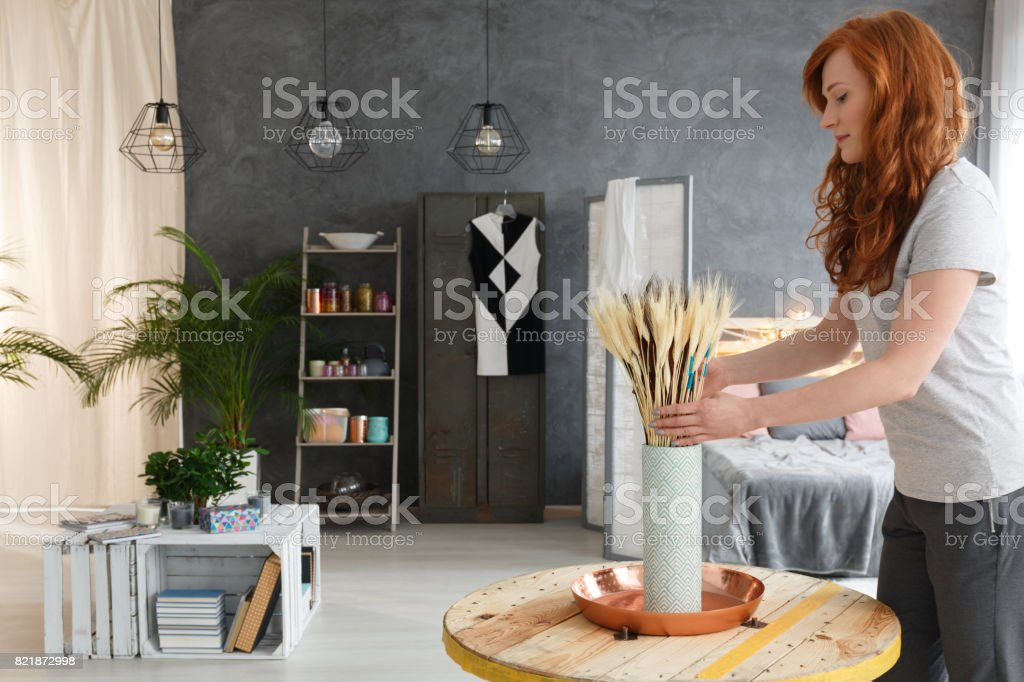 Woman decorating apartment stock photo