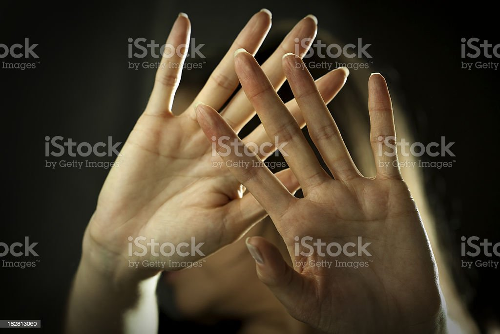Woman defending herself from attack royalty-free stock photo