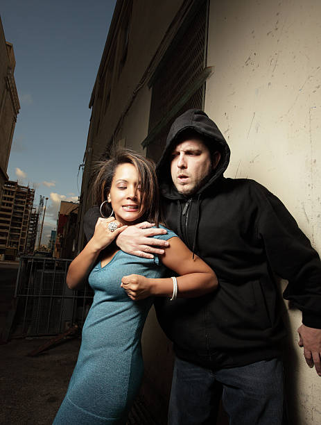 Woman defending herself Woman defending herself from a thug self defense stock pictures, royalty-free photos & images