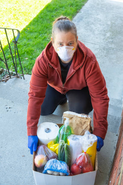 Woman Delivering Wearing An N95 Mask stock photo