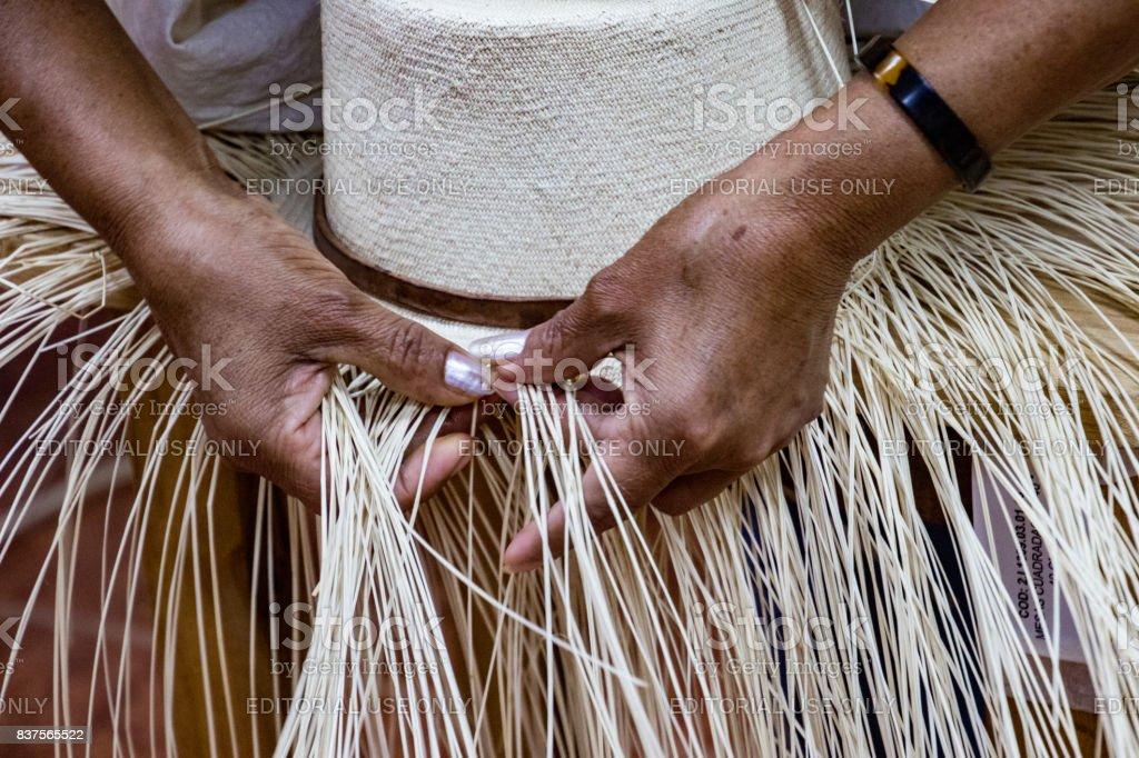Woman demonstrates weaving of Panama Hat stock photo