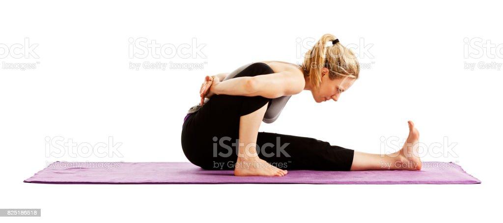 Woman demonstrating Marichyasana A yoga pose stock photo