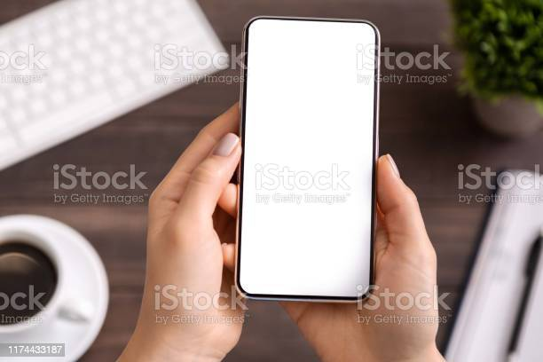 Woman demonstrating modern smartphone with blank white screen picture id1174433187?b=1&k=6&m=1174433187&s=612x612&h=ugx9y2uawqjsosmpxy12zuydb74ymp4tf9lzschcqfm=