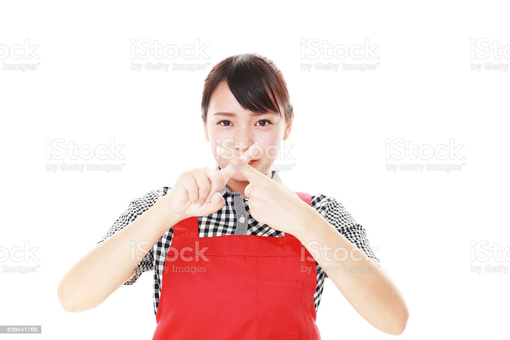 Woman demonstrating prohibiting gesture​​​ foto