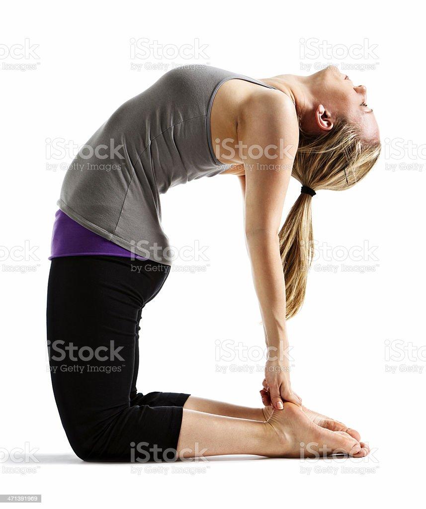 Woman demonstrating Ustrasana (Camel) yoga pose royalty-free stock photo