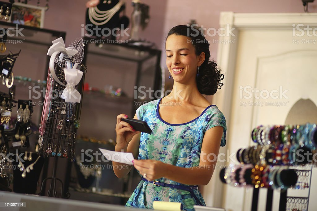 A woman depositing a check using her smartphone stock photo