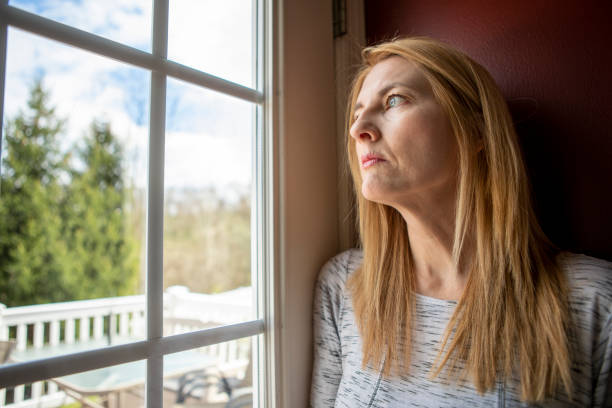 Woman Depressed About Being Stuck Inside House stock photo