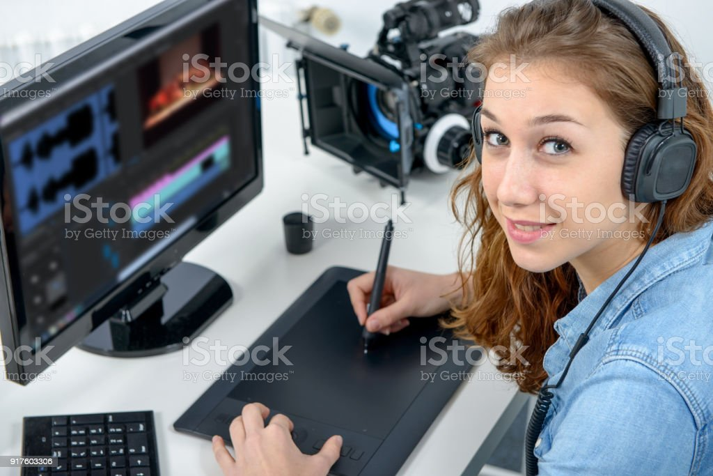 woman designer using a graphics tablet for video editing stock photo