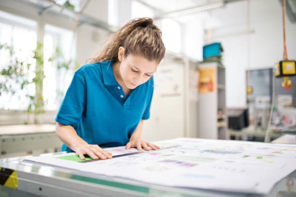 woman designer working at printing factory - printout stock pictures, royalty-free photos & images