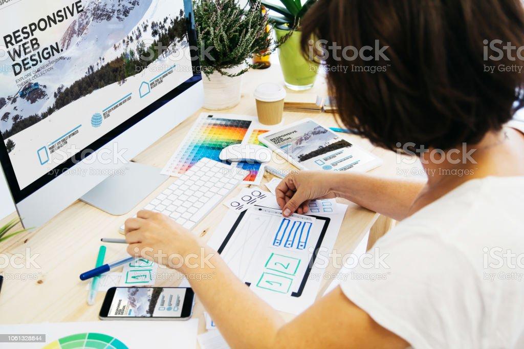 Woman designing gui stock photo