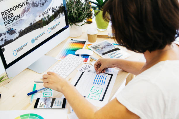 Woman designing gui stock photo