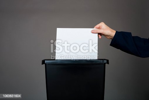 woman destroying documents