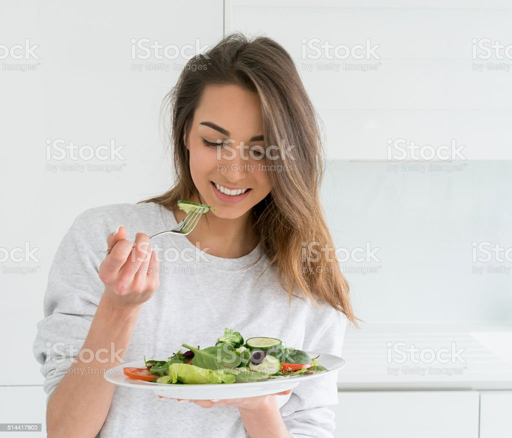 Woman dieting and eating a salad stock photo