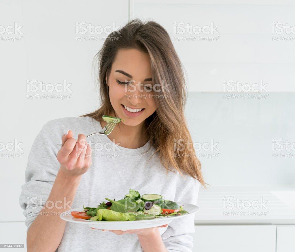 Woman dieting and eating a salad stok fotoğrafı