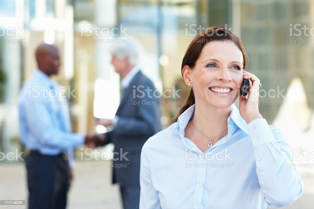 Woman discussing on cell phone royalty-free stock photo
