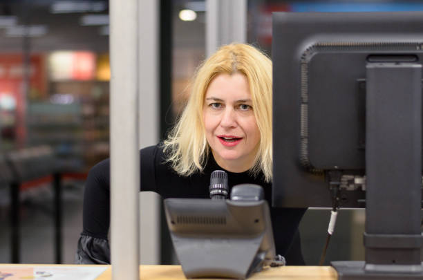Woman dispatcher at workplace stock photo