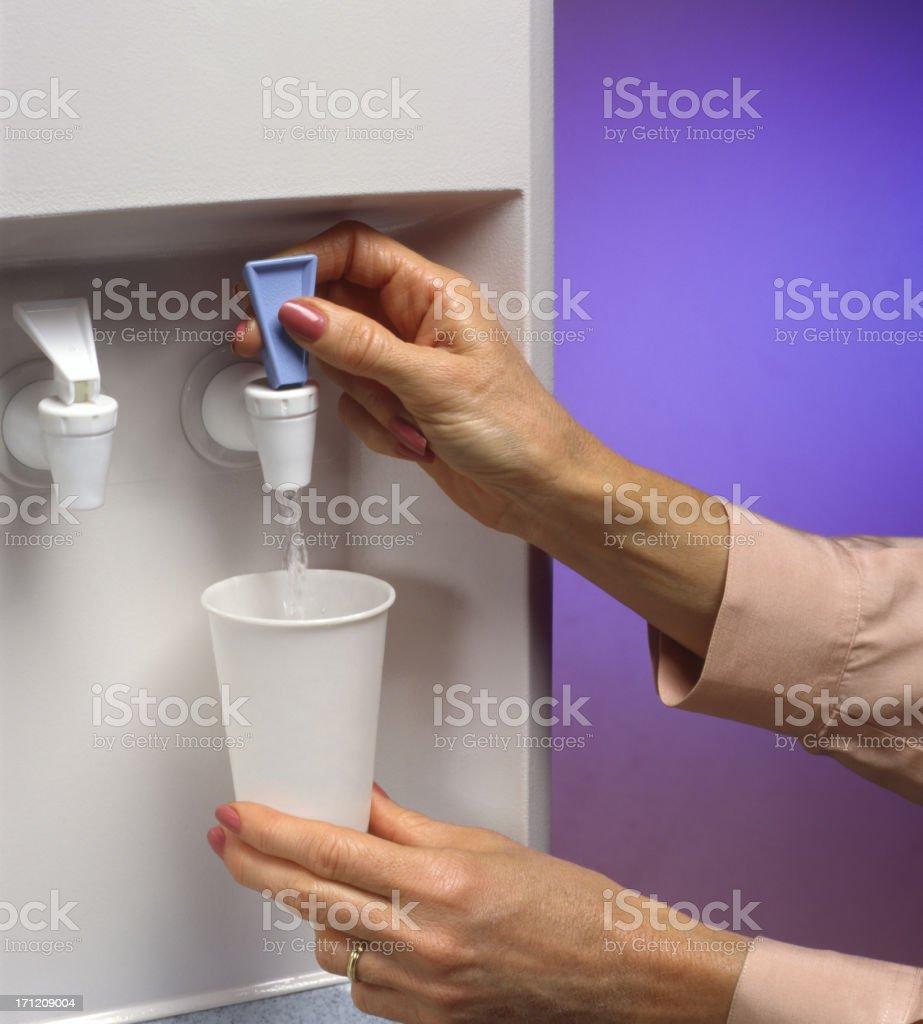Woman dispensing water royalty-free stock photo