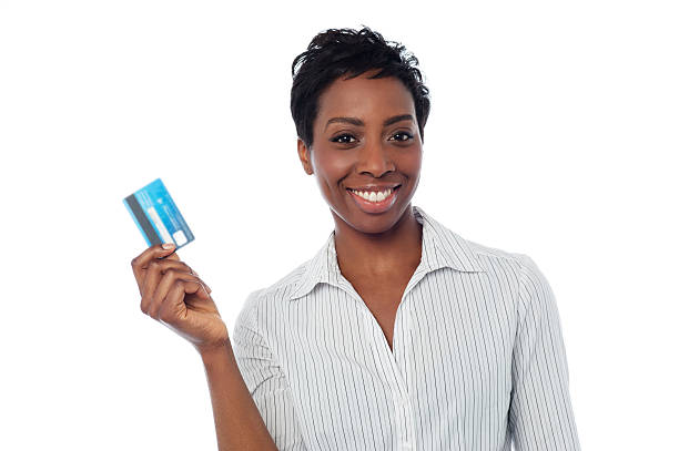 Woman displaying her cash card stock photo