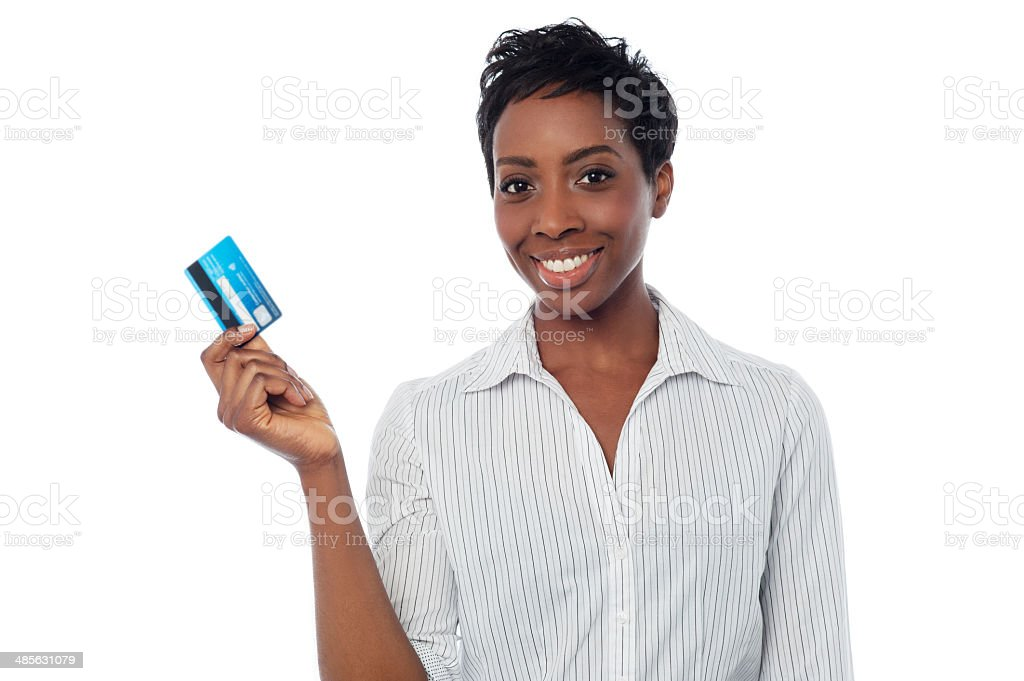 Woman displaying her debit card stock photo
