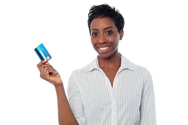Woman displaying her debit card stock photo