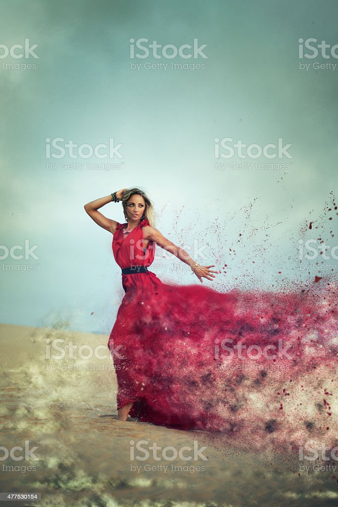 Woman dissapearing in the desert stock photo