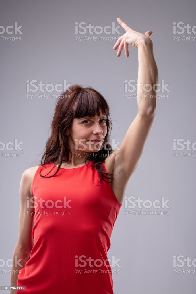 Woman diva gesturing with her hand stock photo