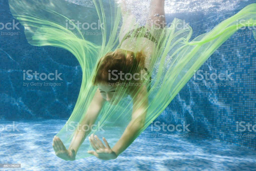 Woman dives with a fabric. stock photo
