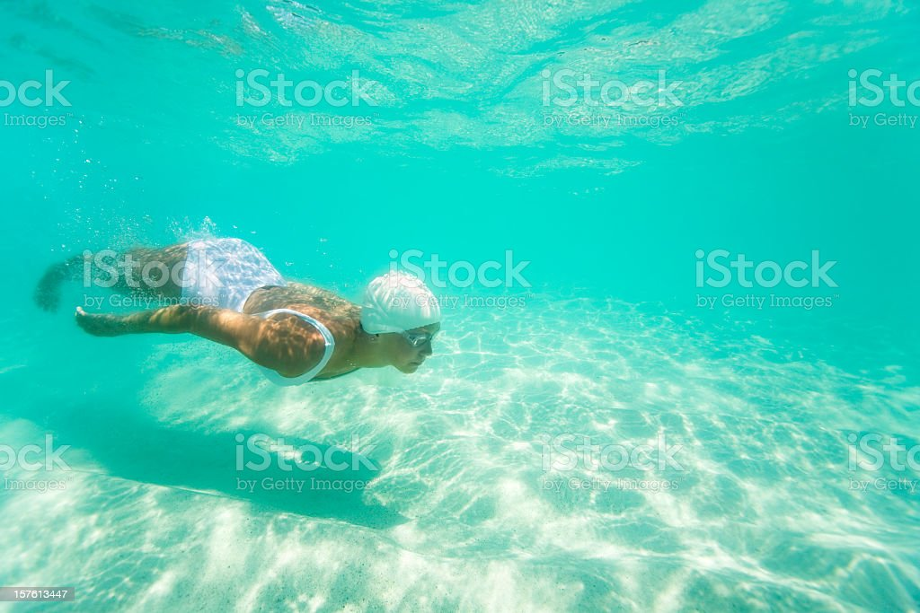 woman diving underwater stock photo