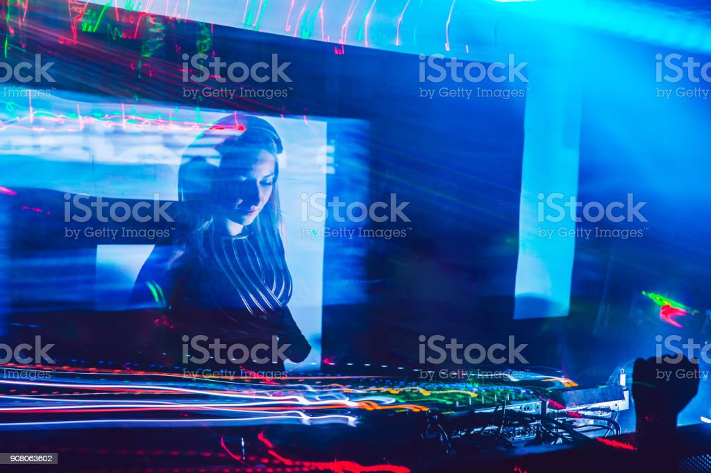 Woman Dj Mixing Music On Stage Stock Photo - Download Image