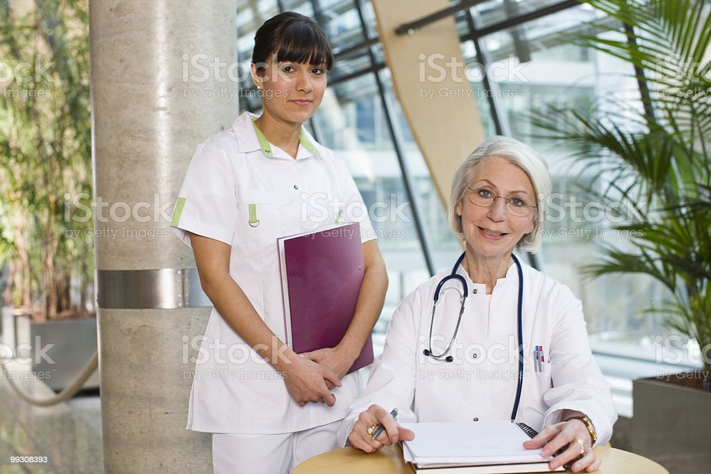 Woman doctor and a young nurse royalty-free stock photo