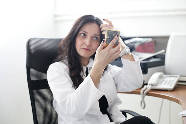 woman doctor checking her hair - frisuren 2016 frauen stock-fotos und bilder