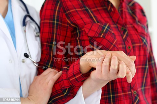 1041630080istockphoto Woman doctor hands holding female child patient hand 526849244