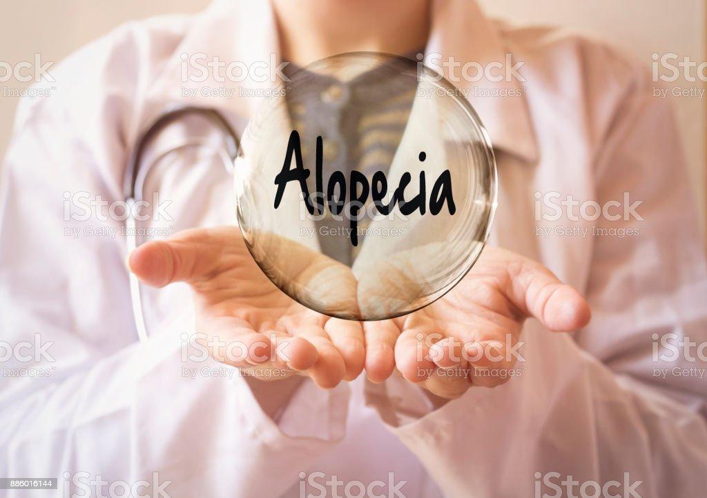 woman doctor holding a transparent bubble with alopecia text, alopecia concept stock photo