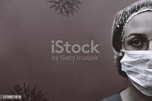 Woman doctor in medical mask, copy space for text on black background. Coronavirus epidemic, flu virus black and white concept. Stay at home