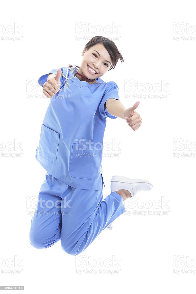 woman doctor jumping with thumb up royalty-free stock photo