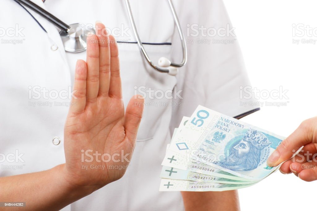 Woman doctor refusing bribes or kickbacks, concept of corruption stock photo