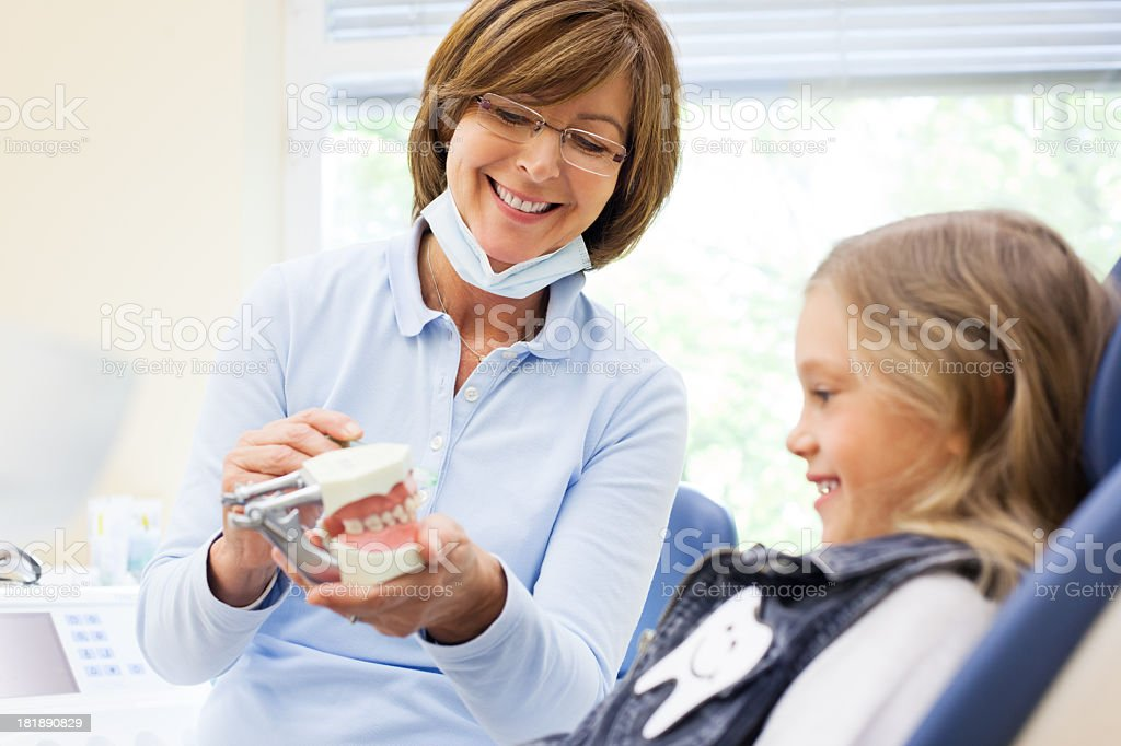 Woman Doctor speaking to young child patient stock photo