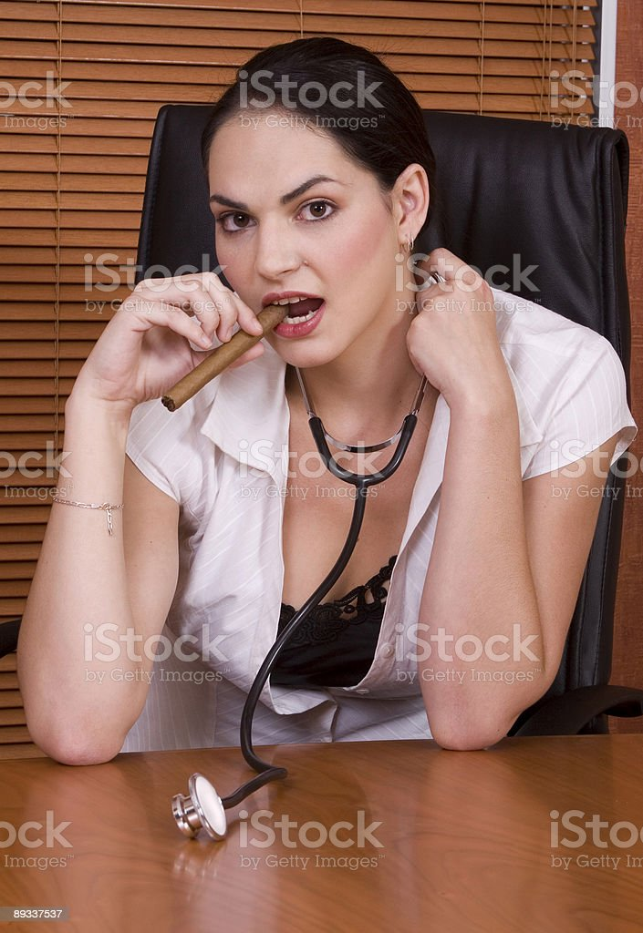 Woman doctor stethoscope cigar royalty-free stock photo
