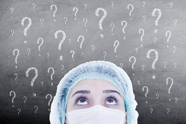 woman doctor thinking on blackboard - question mark asking doctor nurse stock photos and pictures
