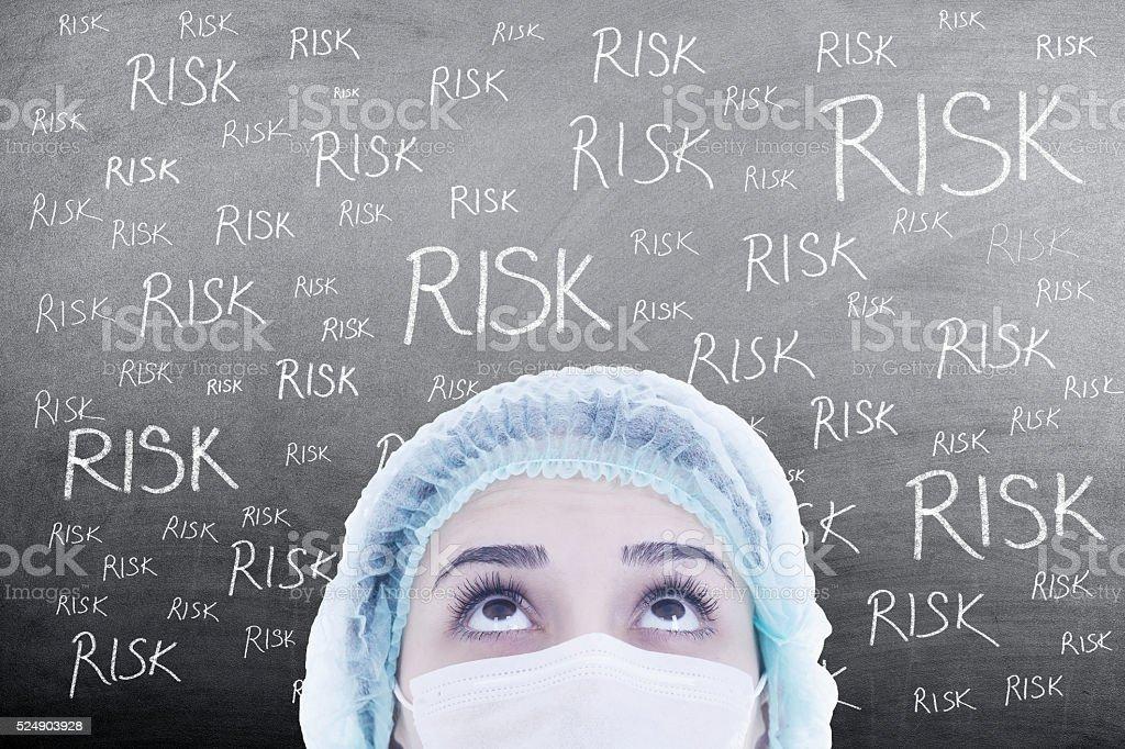 woman doctor thinking on blackboard stock photo