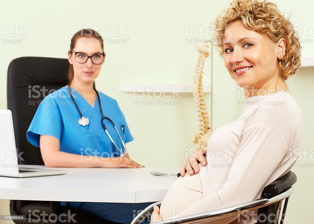 Woman doctor with a patient in treatment stock photo