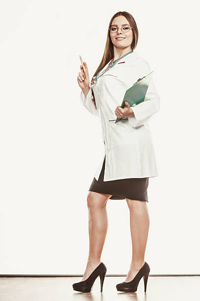 Woman doctor with stethoscope, clipboard and pen. stock photo
