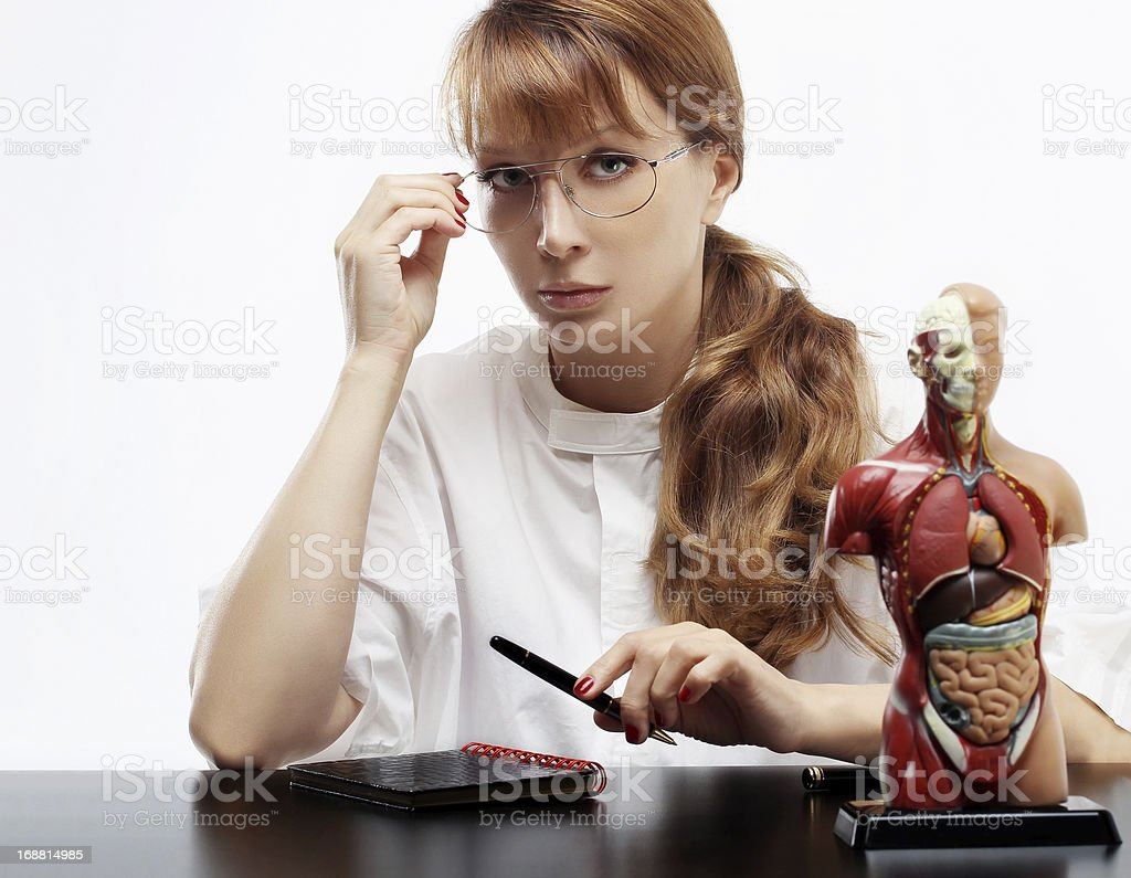 Woman doctor working at her desk royalty-free stock photo