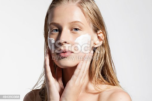istock Woman does a moisturizer on your face 494350368