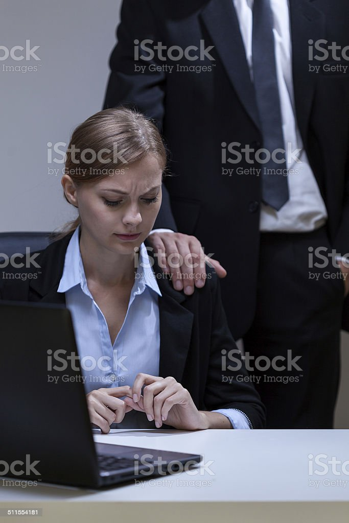 Woman doesn't like boss's touch stock photo