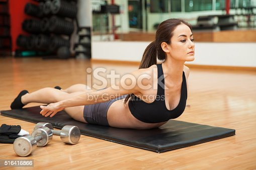 istock Woman doing a back curl at the gym 516416866