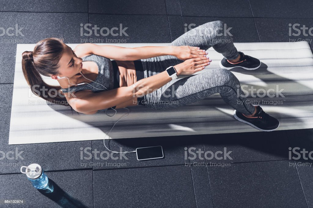 woman doing abs exercises royalty-free stock photo